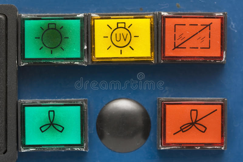 Buttons on old safety cabinet royalty free stock photography
