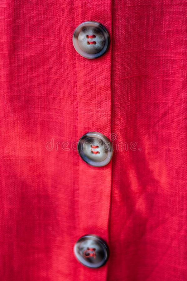 Buttons on red dress macro shot. Shirt, cloth, closeup, classic, women, accessory, blank, shopping, style, design, color, couture, female, stylish, white stock images