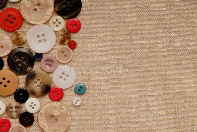 Buttons on sackcloth. Various buttons are on sackcloth royalty free stock photos