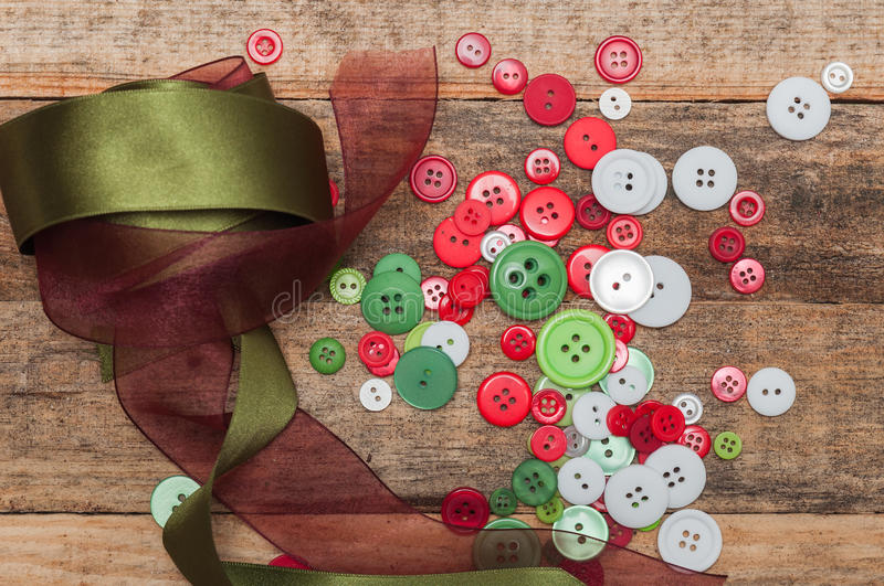 Buttons stack and laces on wooden background royalty free stock photos