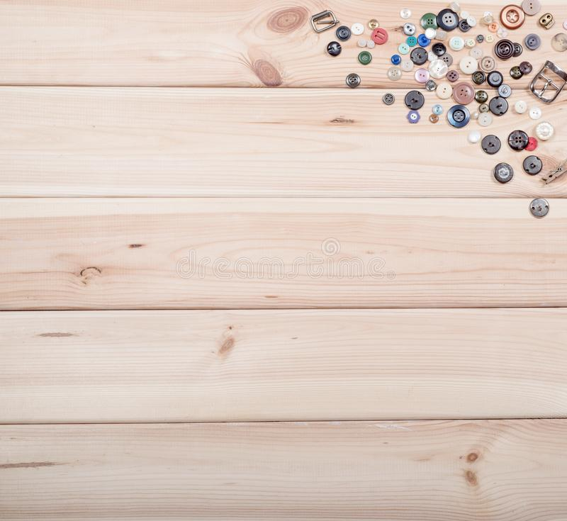 Buttons on wooden background. Copy space. Hobby, sewing royalty free stock images