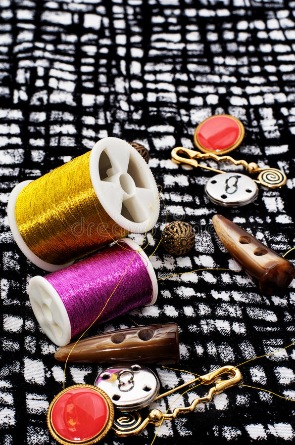 Buttons. And zipper on the background of sewing tool royalty free stock images