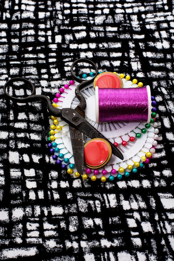 Buttons. And zipper on the background of sewing tool royalty free stock photo