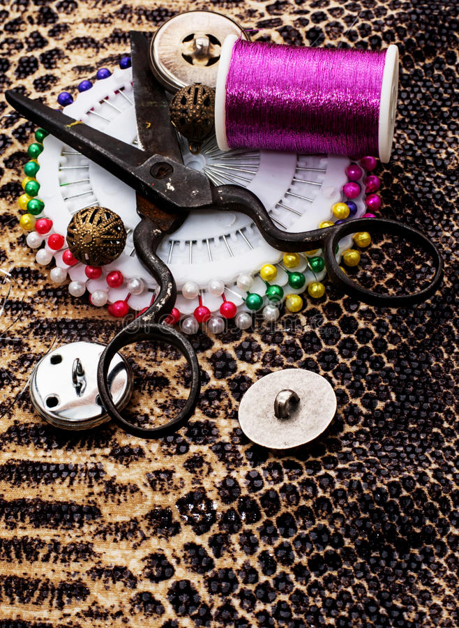 Buttons. And zipper on the background of sewing tool stock photo