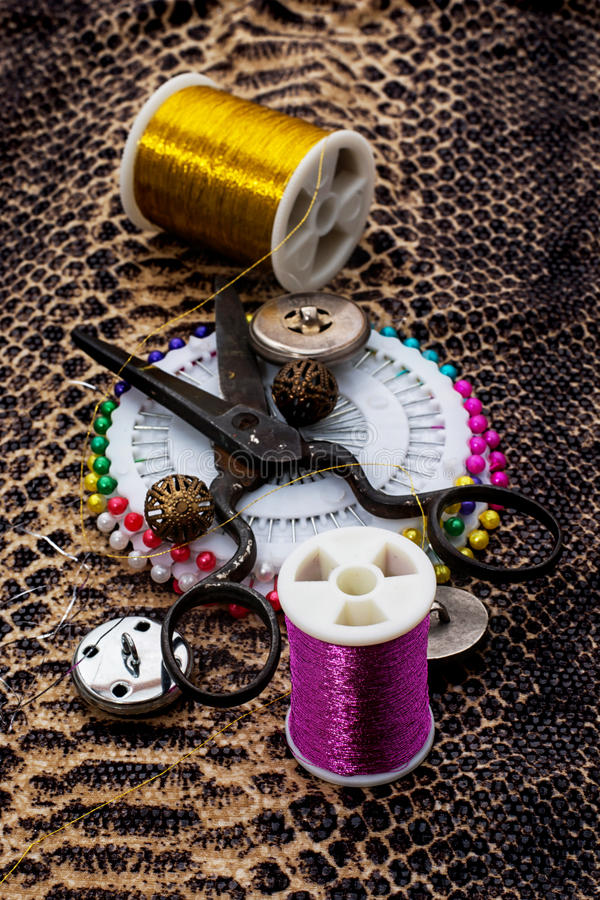 Buttons. And zipper on the background of sewing tool stock photos