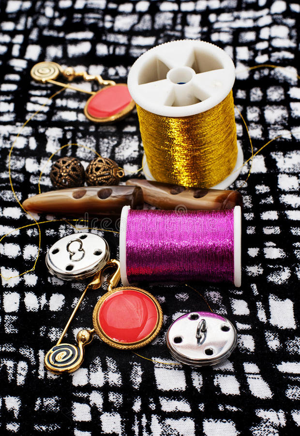 Buttons. And zipper on the background of sewing tool stock photography