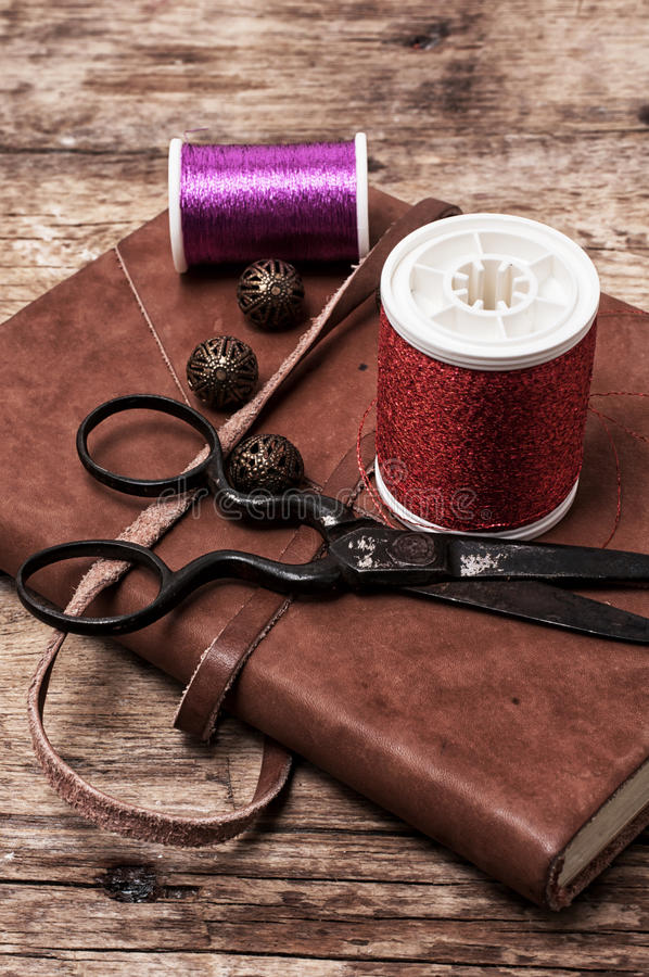 Buttons. And zipper on the background of sewing tool stock images