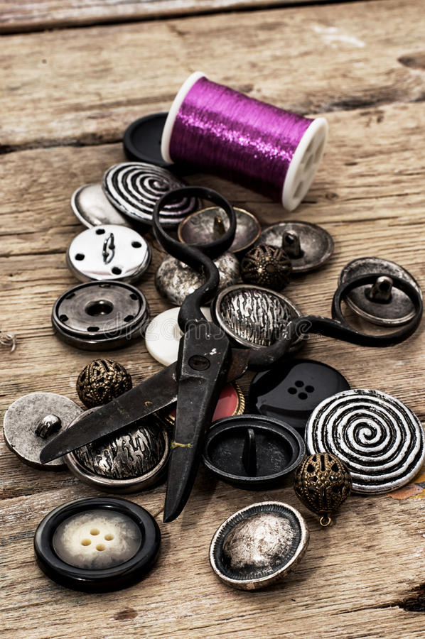 Buttons. And zipper on the background of sewing tool royalty free stock photography