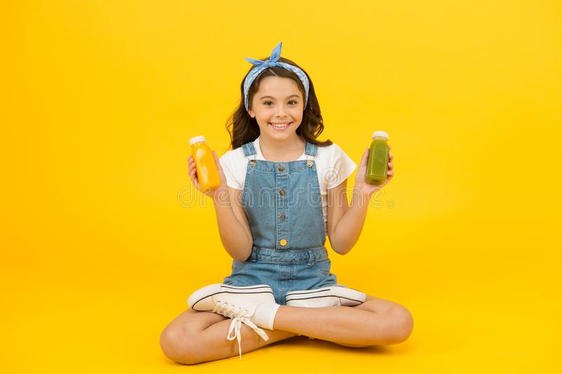 Buy diet food. Happy little child hold bottles with diet food. Small girl enjoy natural diet. Feel nourished and. Energized with diet meal. Healthy dieting royalty free stock photos