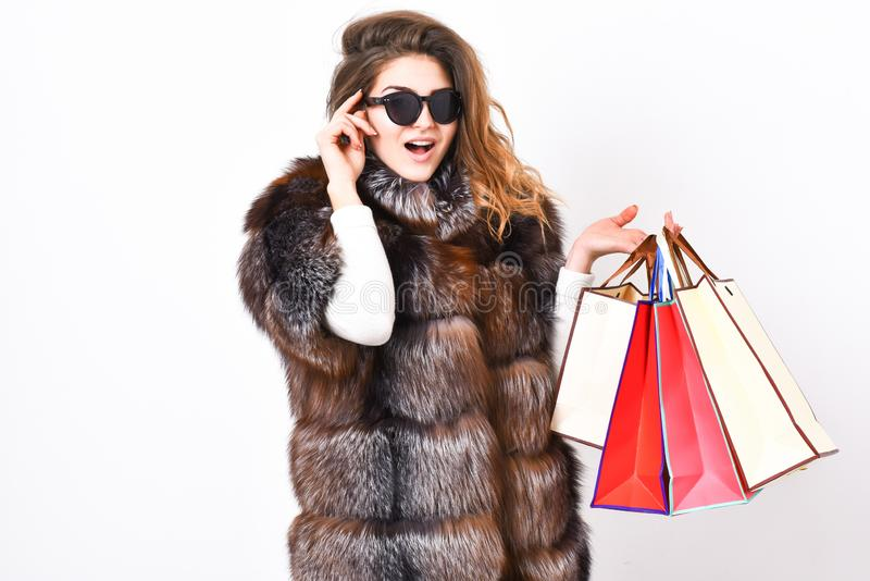 Buy with discount on black friday. Shopping or birthday gift. Girl wear sunglasses and furry coat shopping white. Background. Woman shopping luxury boutique stock photos