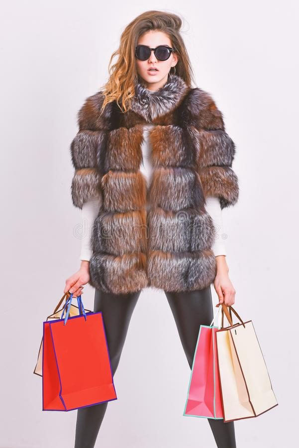 Buy with discount on black friday. Shopping with promo code. Woman shopping luxury boutique. Girl wear sunglasses and. Fur coat shopping white background. Lady stock photo