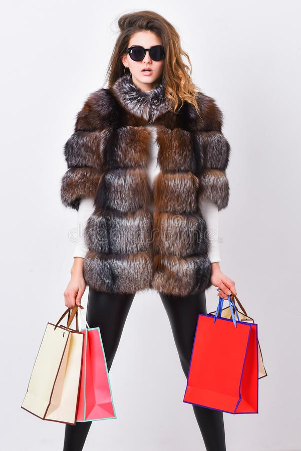 Buy with discount on black friday. Shopping with promo code. Woman shopping luxury boutique. Girl wear sunglasses and. Fur coat shopping white background. Lady stock image