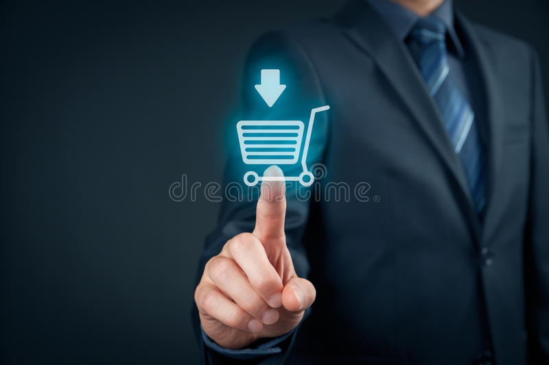 Buy on e-shop. Businessman click on virtual e-shop button with shopping cart. E-commerce and B2C, man buy or download online concept stock images