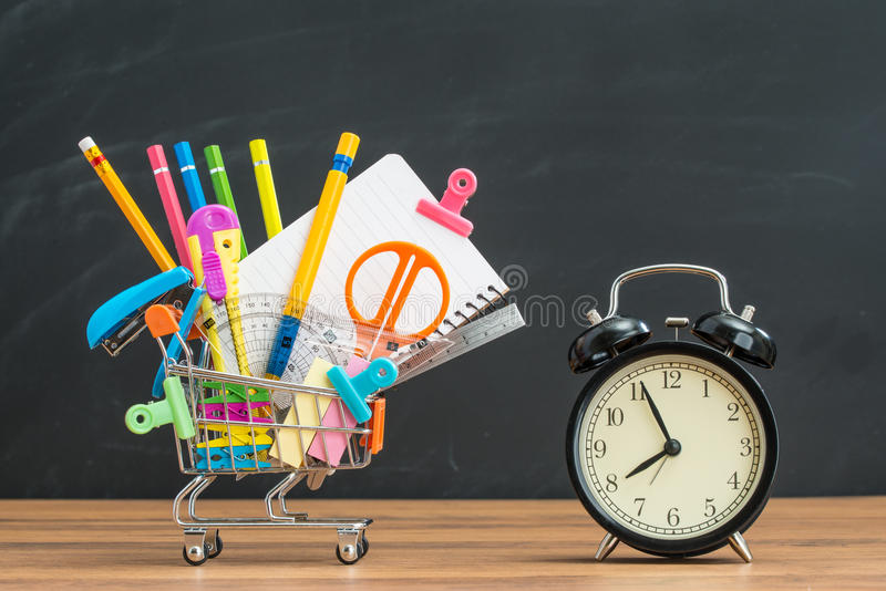 Buy educational supplies with alarm clock for back to school stock image