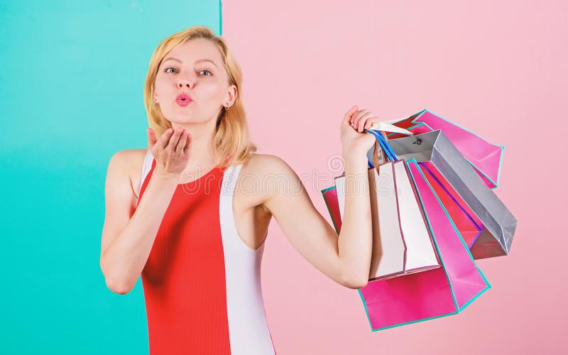 Buy everything you want. Girl satisfied with shopping. Tips to shop sales successfully. Girl enjoy shopping or just got. Birthday gifts. Woman red dress hold stock photos