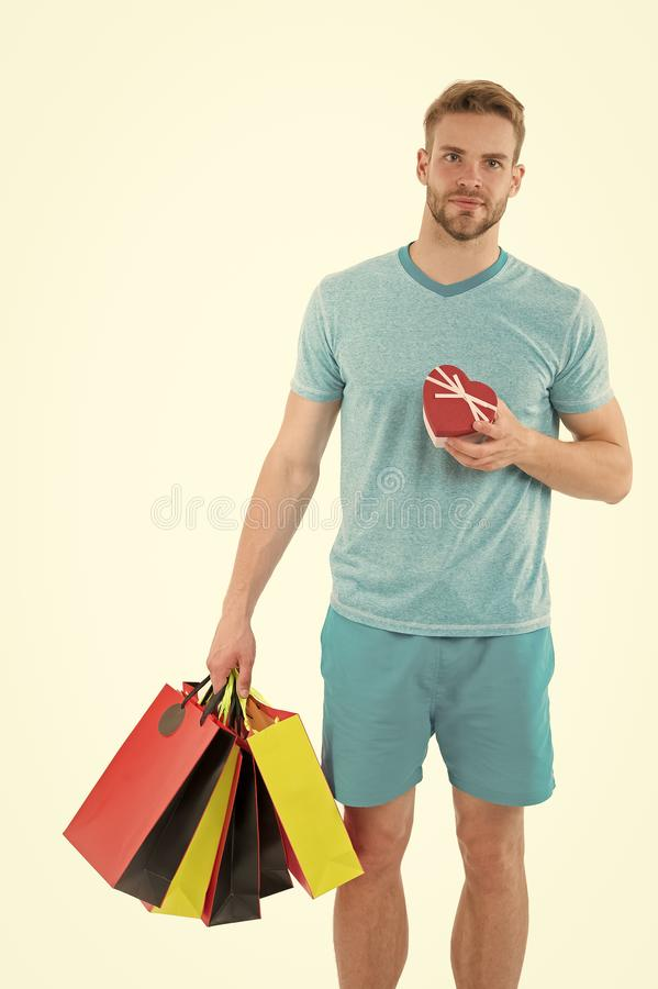 Buy gift for her. Man handsome unshaved macho hold bunch shopping bags. Buy gifts concept. Guy shopping before holidays royalty free stock images