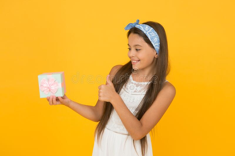 Buy gift. Online shopping. Perfect gift concept. Celebrate holidays. Cute small kid adorable dress. Girl long hair hold. Gift box. Present for teen girl stock images