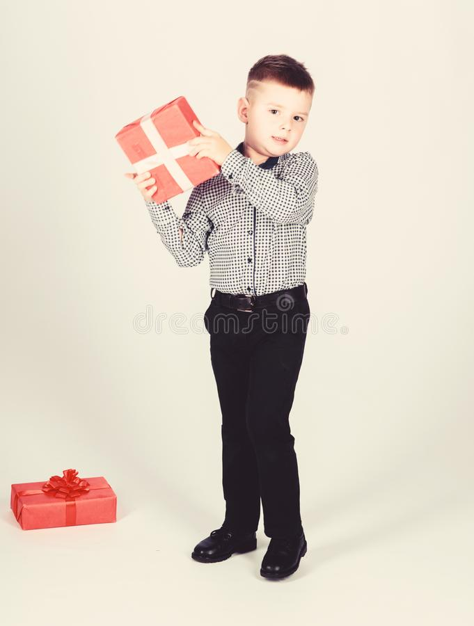 Buy gifts. Holiday shopping seasonal sale. Wellbeing and positive emotions. Celebrate new year valentines day. Birthday. Gift. Small boy hold gift box royalty free stock images