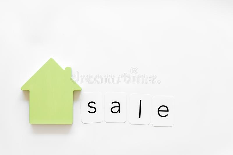 Buy house with house figure and sale copy on office desk white background top view mock-up. Property insurance concept. Buy house with house figure and sale copy royalty free stock photos