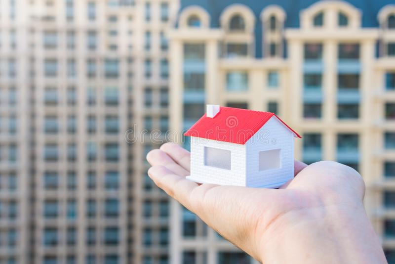 Buy a house, put a model of the house in hand. N royalty free stock image
