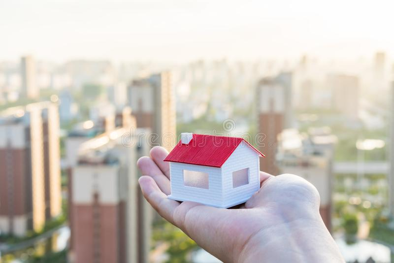 Buy a house, put a model of the house in hand. N royalty free stock photos