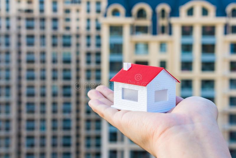 Buy a house, put a model of the house in your hand stock images