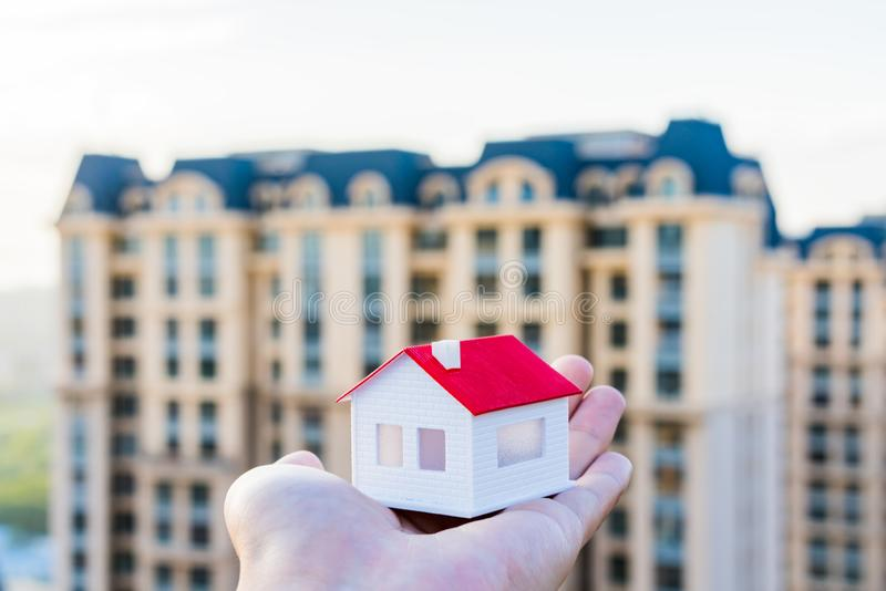 Buy a house, put a model of the house in your hand stock photography