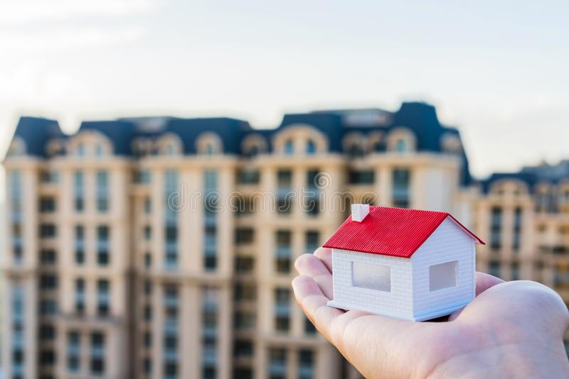 Buy a house, put a model of the house in your hand royalty free stock photo