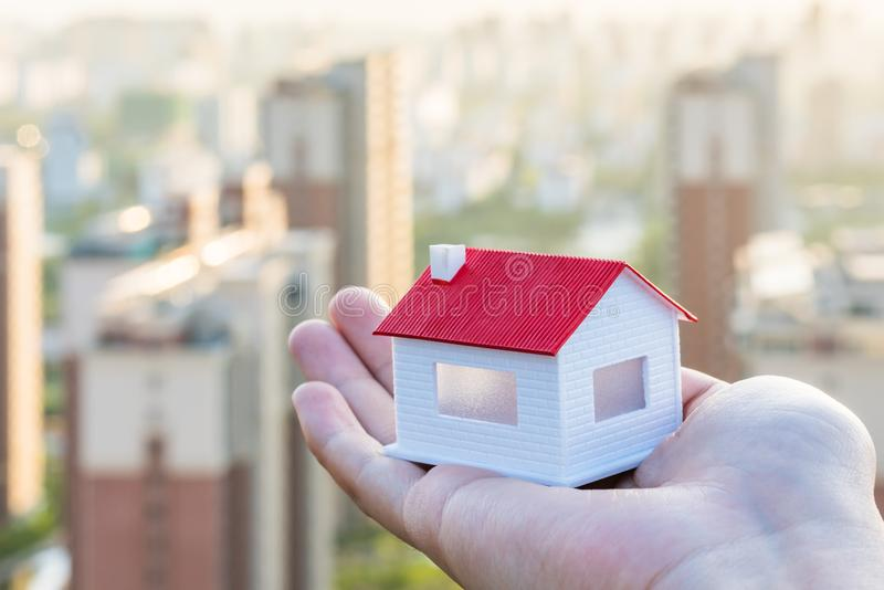 Buy a house, put a model of the house in your hand royalty free stock photography