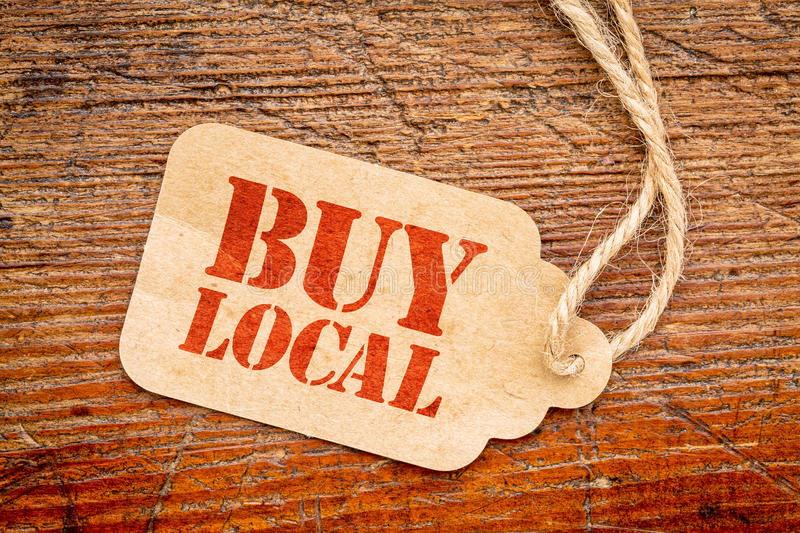 Buy local sign on a price tag stock photos