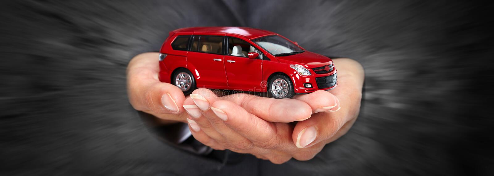 Buy a new car. Woman hands with a car gift. Auto dealership rental concept background royalty free stock photos