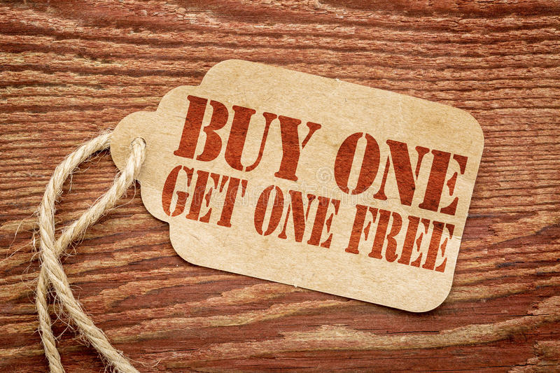 Buy one get one free - paper price tag royalty free stock photography