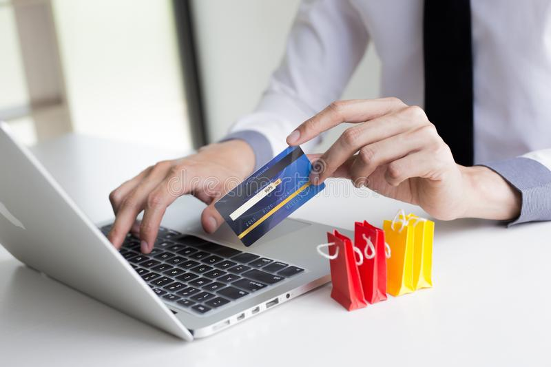 Buy products online, business people are bringing credit cards to pay for purchases. Online credit cards are easy to use. Buy products online, business people royalty free stock photos
