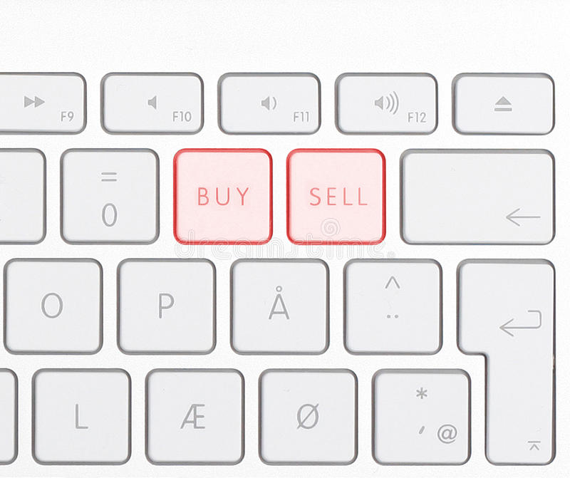 Buy Sell. Keyboard showing buy sell buttons stock photography