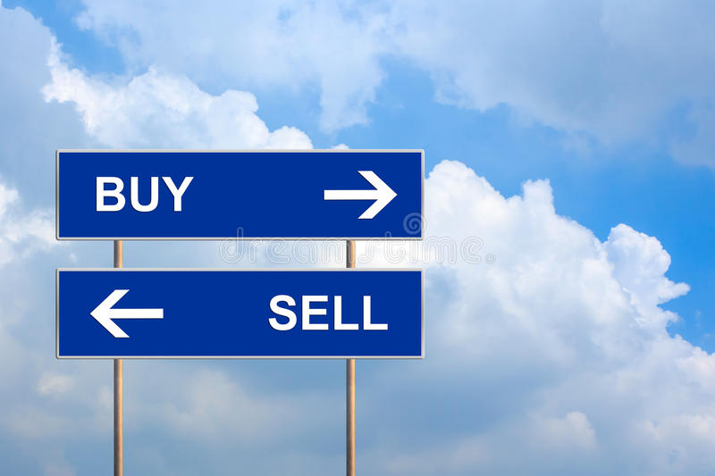 Buy and sell on blue road sign. With blue sky stock images