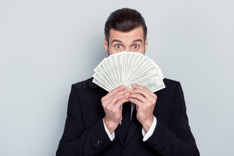 100 buy transfer stock shares people success luck concept. Close. Up portrait of surprised excited amazed wondered glad financier economist hiding face behind royalty free stock photography