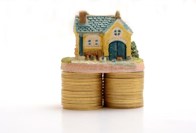 Buy your Dream House miniature on Gold Coins royalty free stock images