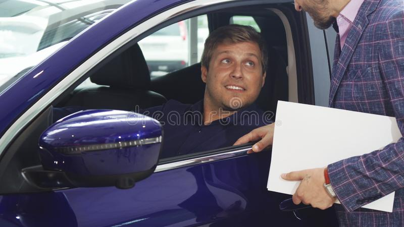 Interested buyer got into the car royalty free stock images