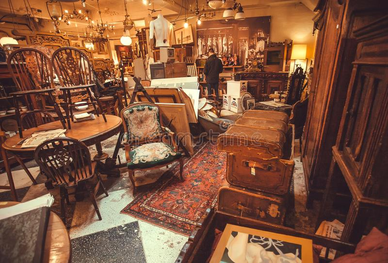 Bon Download Buyers Inside The Antique Shop With Utensils, Lamps, Souvenirs And  Retro Furniture Editorial