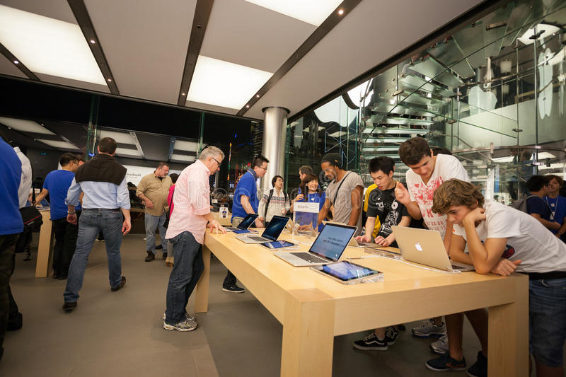 Buyers and sellers in the Apple store in Hong Kong royalty free stock photo