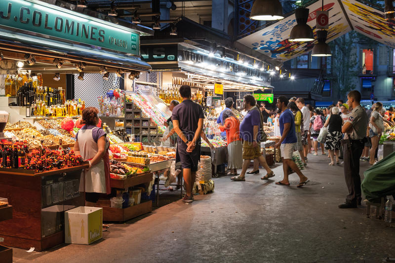 Buyers and sellers of La Boqueria, marketplace in old Barcelona royalty free stock photo