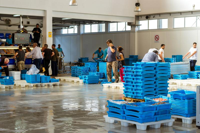 Buyers traded at conveyor, fish auction in Blanes. Blanes, Spain - 31 may, 2018: Buyers are traded at conveyor. Fish auction for wholesalers and restaurants stock photos