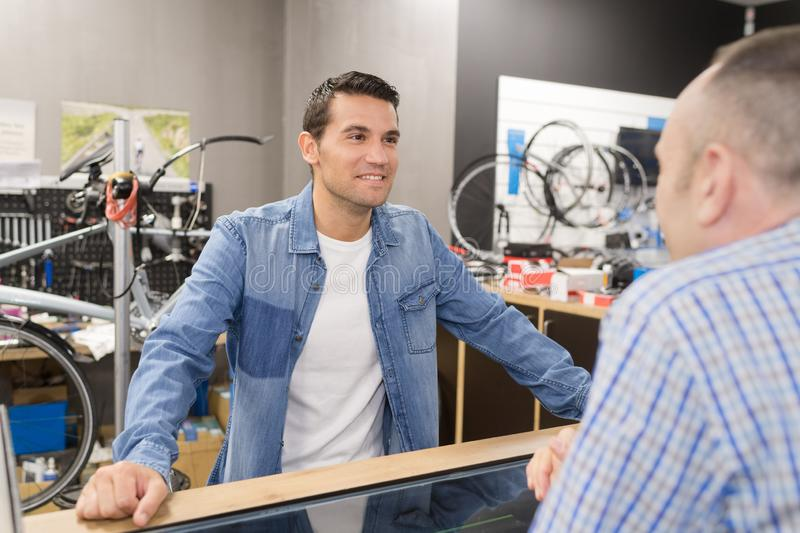 Buying bike for son. Buying a bike for his son stock photos