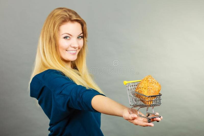 Woman holding shopping cart with bread stock image