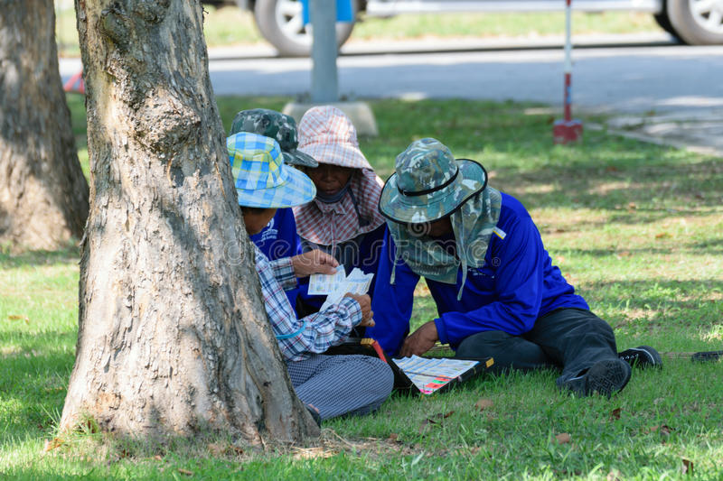 Buying lottery ticket. Bangkok, Thailand - October 25, 2015 : Unidentified Thai workers are buying lottery ticket for hope to lucky royalty free stock photos