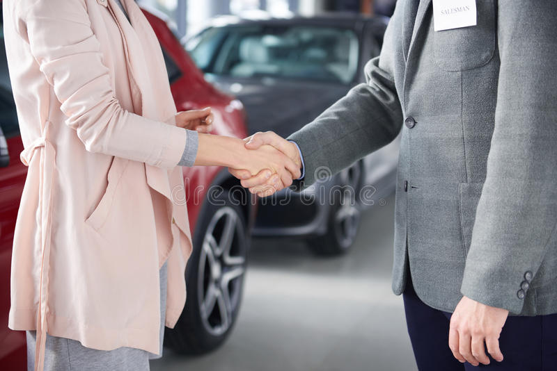 Buying new car by woman royalty free stock images