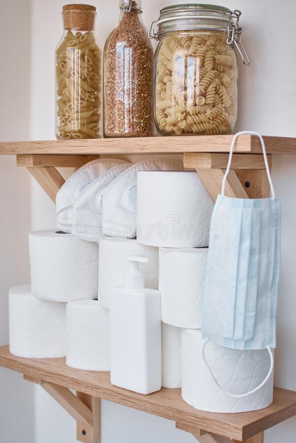 Buying panic for home quarantine due to coronavirus. Stay at home for covid-19 protection concept. Stocks of a toilet paper rolls royalty free stock photos
