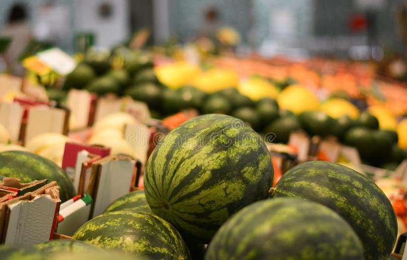 The great variety of fruits and vegetables that can be found in shopping centers. Buying and selecting in the supermarkets of shopping malls, is now a habit of stock images