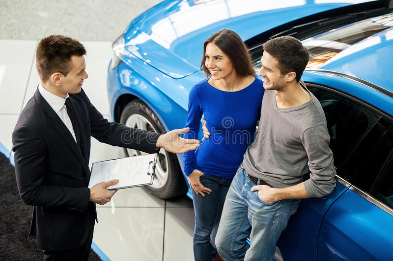 Buying their first car together. royalty free stock photos