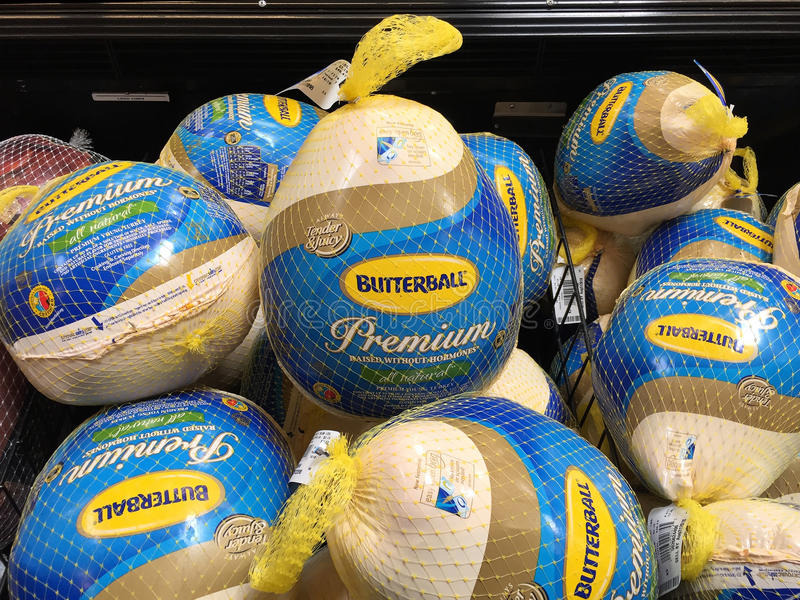 Buying A Turkey In A Supermarket for Thanksgiving. royalty free stock photography